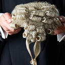 barristers in gown holding wig