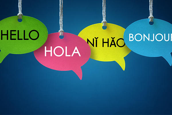 Four speech bubbles with the word 'hello' in different languages
