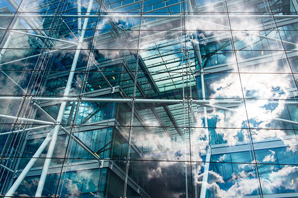 Building windows with sky reflected